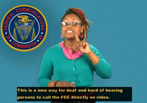 An African-American female using American Sign Language to describe the FCC's Direct Video Calling program for individuals using American Sign Language