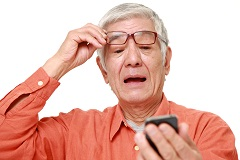 Older Man Looking at Cellphone with Surprise  thumbnail image