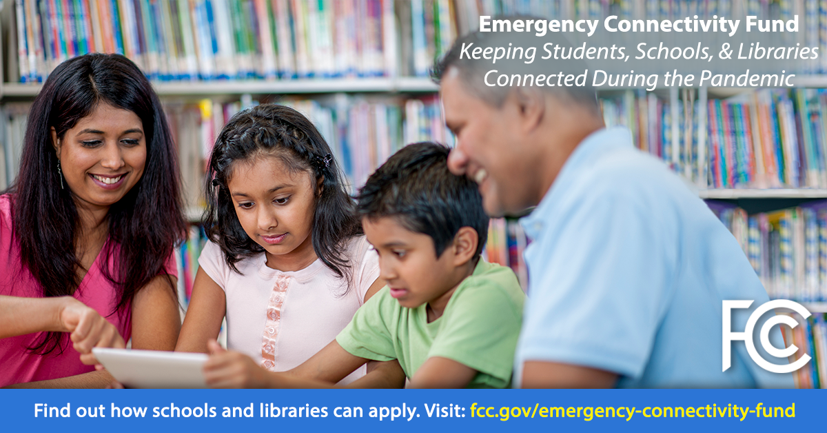 Emergency Connectivity Fund - family at table in library looking at a tablet computer
