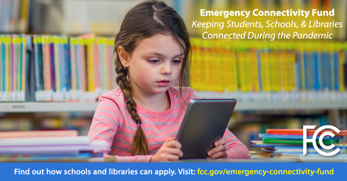 Emergency Connectivity Fund - girl with ponytail in library looking at a tablet computer