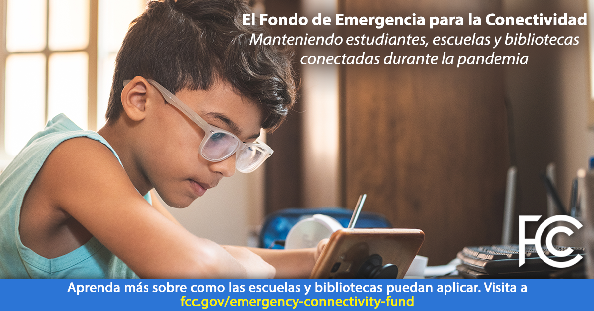 Image with Spanish text: Emergency Connectivity Fund - boy with glasses at a desk holding a pen looking at a phone