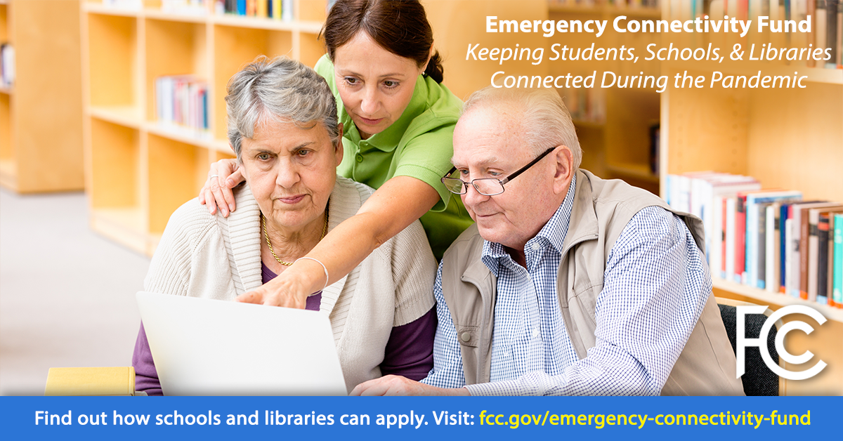Emergency Connectivity Fund - woman helping senior couple with a laptop computer at a library table