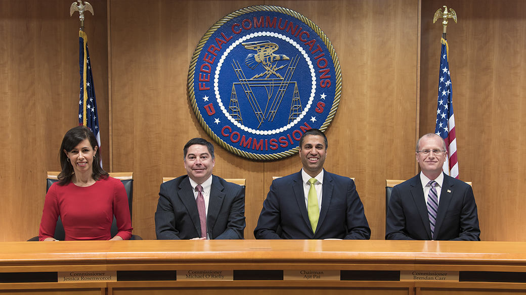 Commissioners Group Photo, June 7, 2018: L to R:  Commissioner Jessica Rosenworcel, Commissioner Michael O'Rielly, Chairman Ajit Pai and Commissioner Brendan Carr. Click for print version.