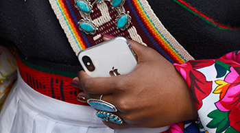 Native American Woman Holding a Smartphone