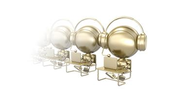Line of gold colored metallic robots at desks with headphones and laptops - Robocall